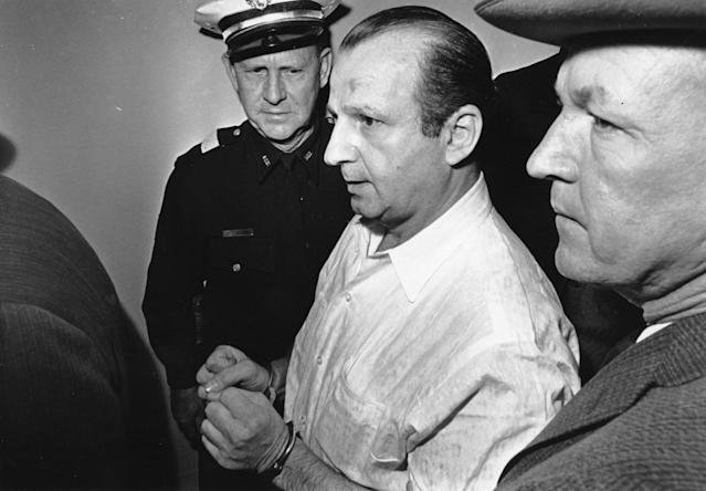 <p>Nightclub owner Jack Ruby is led through the Dallas city jail on his way to his arraignment in Dallas on Nov. 24, 1963. Ruby was charged in the murder of Lee Harvey Oswald, the suspect accused of assassinating President John F. Kennedy. Others are unidentified. (Photo: AP) </p>