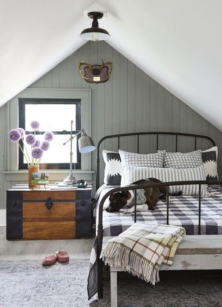 """<p>Contrasting colors like a whitewashed ceiling and an accent wall painted with <a href=""""https://go.redirectingat.com?id=74968X1596630&url=https%3A%2F%2Fwww.homedepot.com%2Fp%2FBEHR-1-qt-BCP24-Dusty-Laurel-Interior-Chalk-Decorative-Paint-710004%2F306903334&sref=https%3A%2F%2Fwww.popularmechanics.com%2Fhome%2Fg37190959%2Fpaint-colors-small-rooms%2F"""" rel=""""nofollow noopener"""" target=""""_blank"""" data-ylk=""""slk:Dusty Laurel by Behr"""" class=""""link rapid-noclick-resp"""">Dusty Laurel by Behr</a> make this lofted bedroom feel larger. Repurpose a vintage trunk as a nightstand for even more added storage.</p>"""