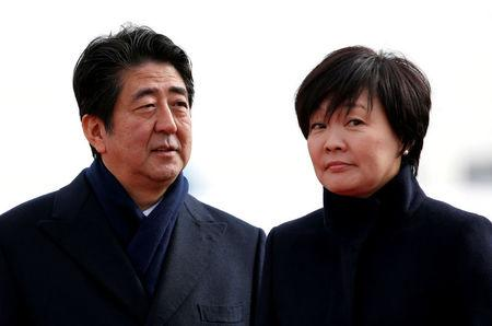 FILE PHOTO: Japan's PM Abe and his wife Akie are pictured at Tokyo's Haneda Airport