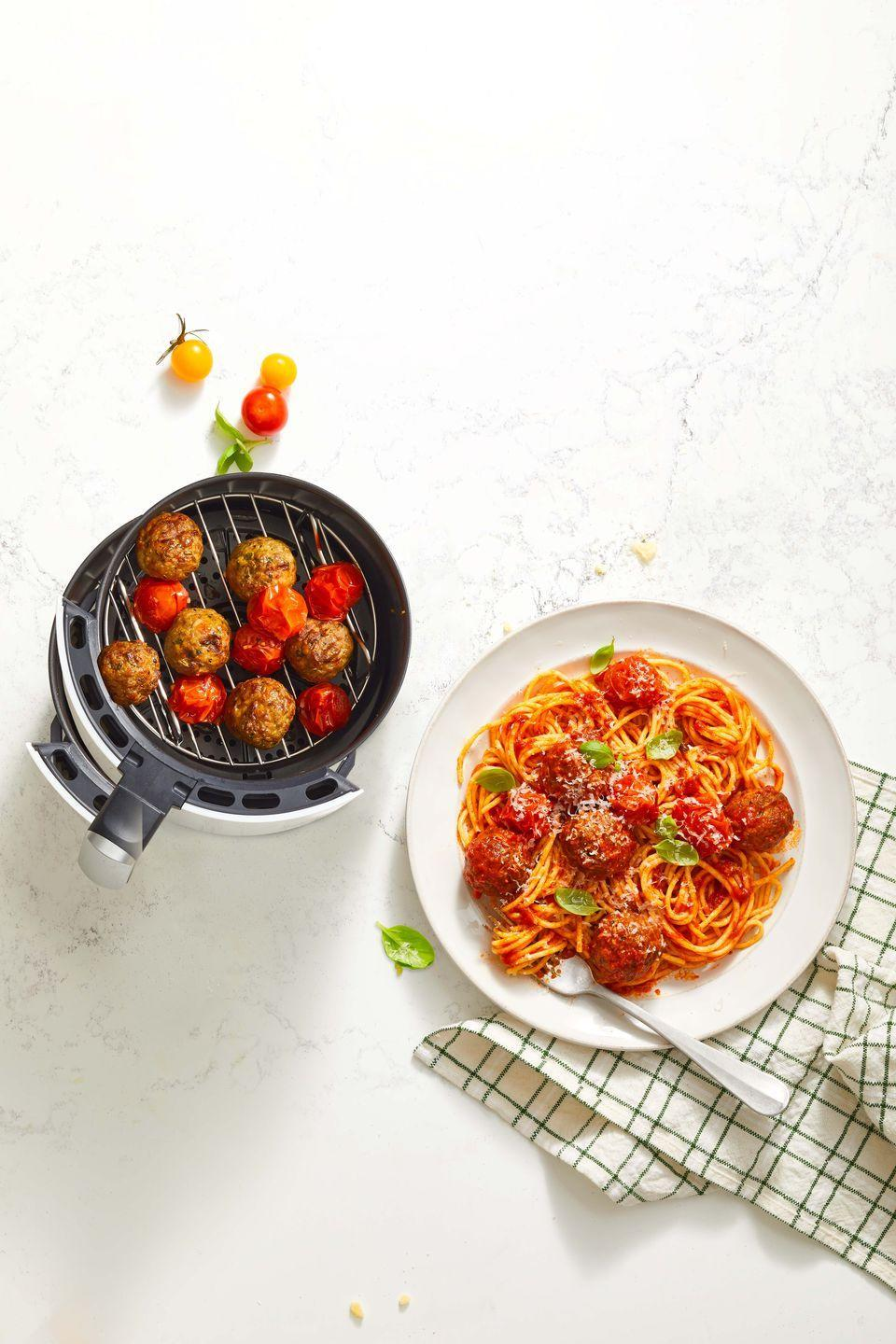 """<p>Forget frying meatballs on the stovetop (so messy!) or baking them in the oven—air fryer meatballs are a cinch to make and even easier to clean up. </p><p><em><a href=""""https://www.goodhousekeeping.com/food-recipes/easy/a37145375/air-fryer-meatballs-recipe/"""" rel=""""nofollow noopener"""" target=""""_blank"""" data-ylk=""""slk:Get the recipe for Spaghetti and Air Fryer Meatballs »"""" class=""""link rapid-noclick-resp"""">Get the recipe for Spaghetti and Air Fryer Meatballs »</a></em></p>"""