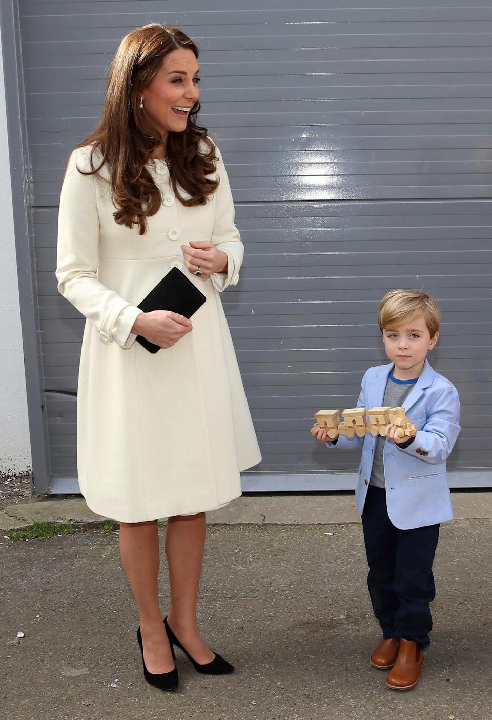 <p>The Duchess visited the set of Downton Abbey wearing a cream maternity coat by Jojo Maman Bebe. Black Stuart Weitzman pumps and a Mulberry leather clutch finished off the look perfectly. </p><p><i>[Photo: PA]</i></p>