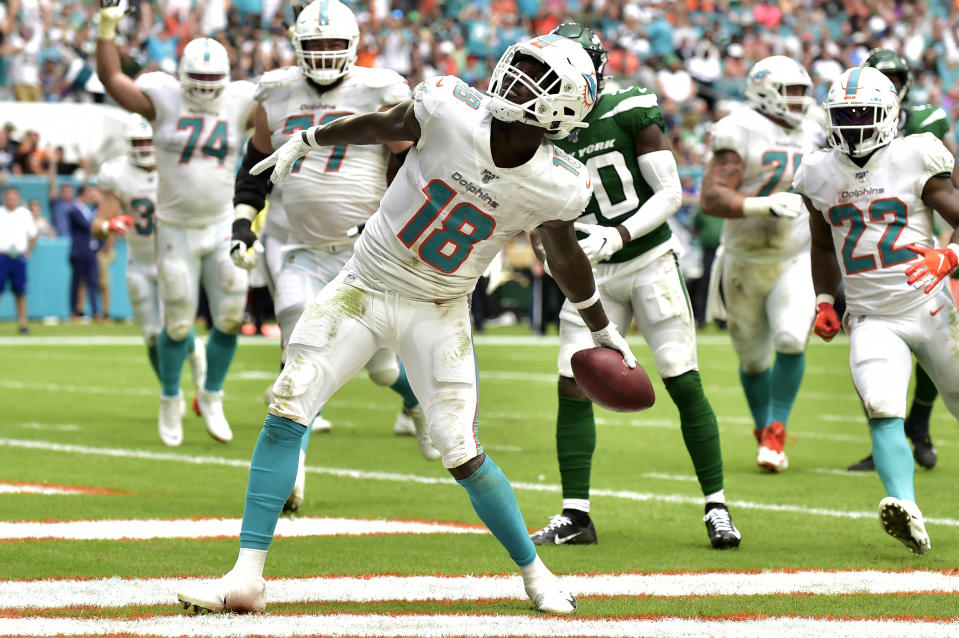 Preston Williams of the Miami Dolphins celebrates after scoring a touchdown against the New York Jets. (Getty Images)