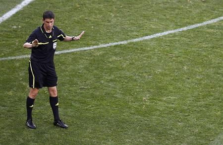 Referee Undiano gestures during a 2010 World Cup Group D soccer match between Germany and Serbia in Port Elizabeth