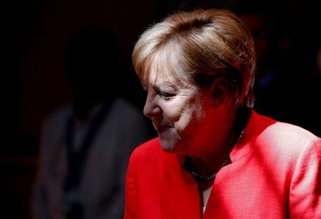 Merkel says open to international talks on slashing car tariffs