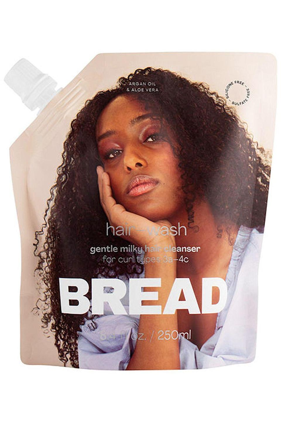 """<p><strong>BREAD BEAUTY SUPPLY</strong></p><p>sephora.com</p><p><strong>$20.00</strong></p><p><a href=""""https://go.redirectingat.com?id=74968X1596630&url=https%3A%2F%2Fwww.sephora.com%2Fproduct%2Fbread-beauty-hair-wash-gentle-milky-hair-cleanser-P460549&sref=https%3A%2F%2Fwww.cosmopolitan.com%2Fstyle-beauty%2Fbeauty%2Fg34358051%2Fblack-owned-hair-products%2F"""" rel=""""nofollow noopener"""" target=""""_blank"""" data-ylk=""""slk:Shop Now"""" class=""""link rapid-noclick-resp"""">Shop Now</a></p><p>You're not going to get a full-on lather with this Black-owned hair product, but don't get confused—it's still putting in work. The cleanser deposits a creamy, lightweight mixture onto your hair that's packed with <a href=""""https://www.cosmopolitan.com/style-beauty/beauty/g33444658/best-oils-for-curly-hair/"""" rel=""""nofollow noopener"""" target=""""_blank"""" data-ylk=""""slk:argan oil"""" class=""""link rapid-noclick-resp"""">argan oil</a>, aloe vera juice, and lemon tea tree oil. <strong>The result is silky, clean, and healthy hair</strong> that you won't be able to stop playing with.</p>"""