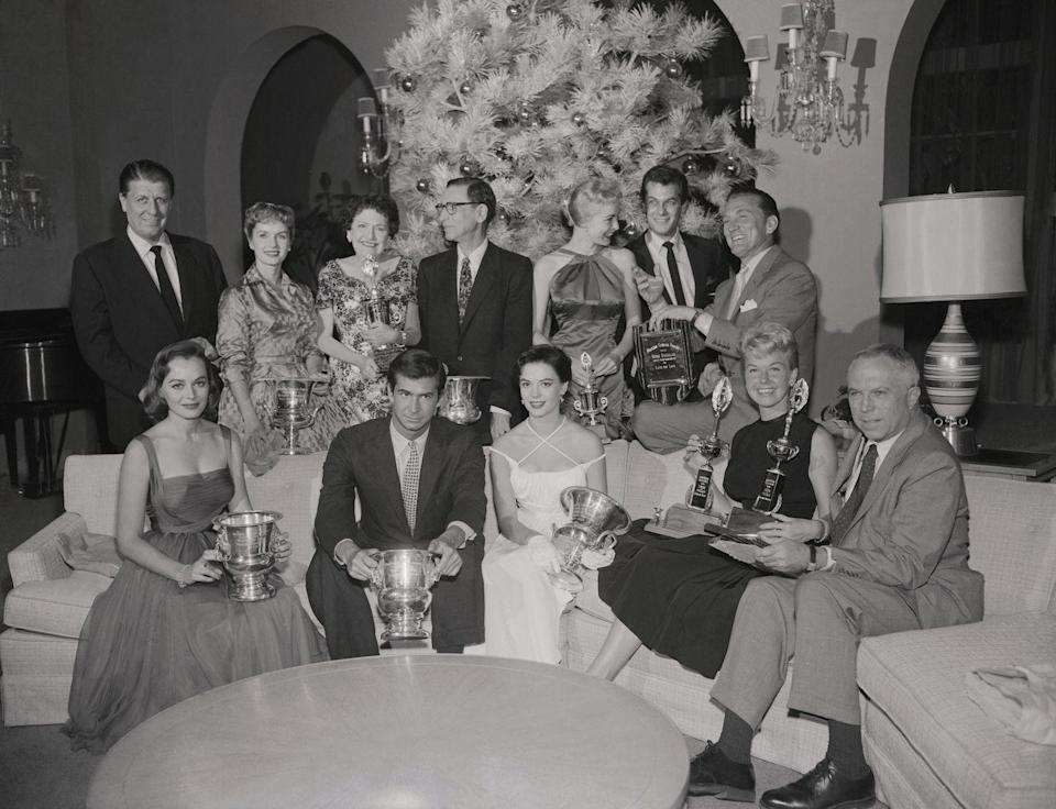 <p>Stars gather for a photo following the Modern Screen Awards on December 2, 1956. </p><p>Front row: Victoria Shaw, Tony Perkins, Natalie Wood, Doris Day, King Vidor. Back row: George Stevens, Debbie Reynolds, Louella Parsons, George Delacorte, Janet Leigh, Tony Curtis, and Kirk Douglas.</p>