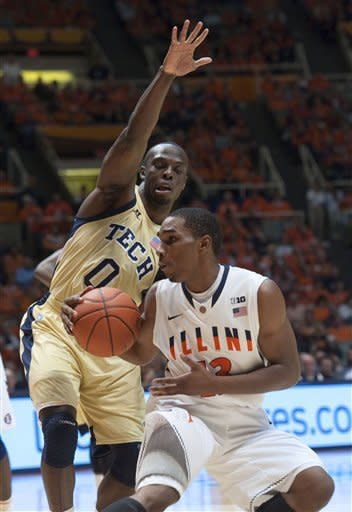Georgia Tech's Mfon Udofia (0) guards Illinois' Tracy Abrams during the first half of an NCAA college basketball game in Champaign, Ill., Wednesday, Nov. 28, 2012. (AP Photo/Robert K. O'Daniell)