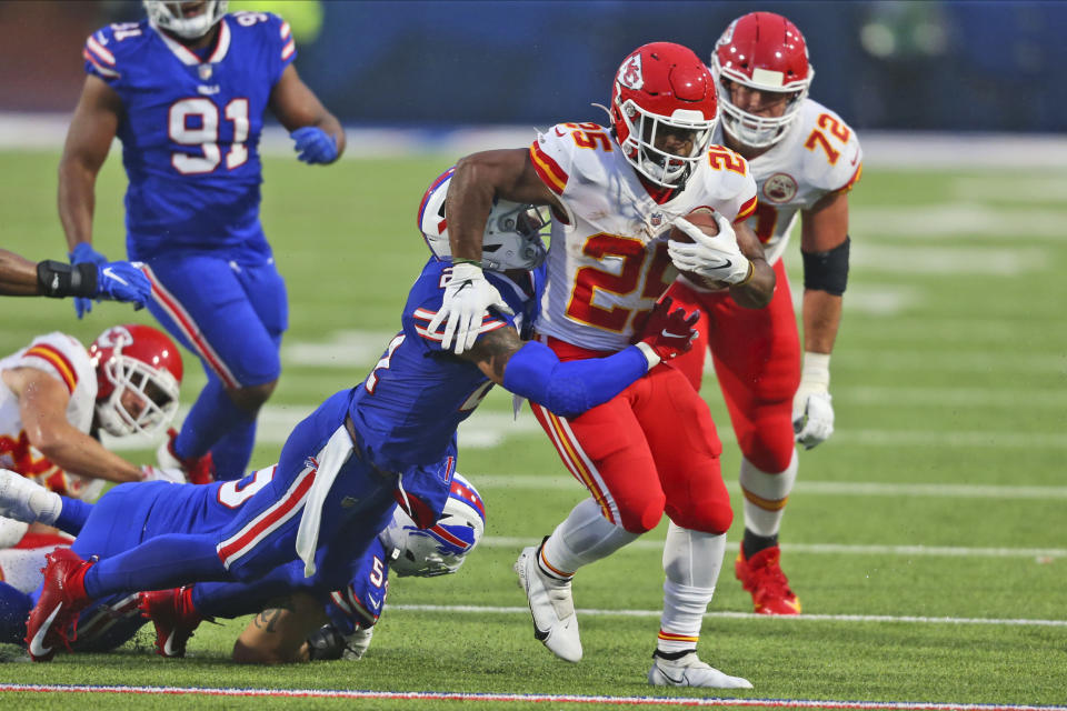 Kansas City Chiefs running back Clyde Edwards-Helaire, right, runs the ball during the first half of an NFL football game against the Buffalo Bills, Monday, Oct. 19, 2020, in Orchard Park, N.Y. (AP Photo/Jeffrey T. Barnes)