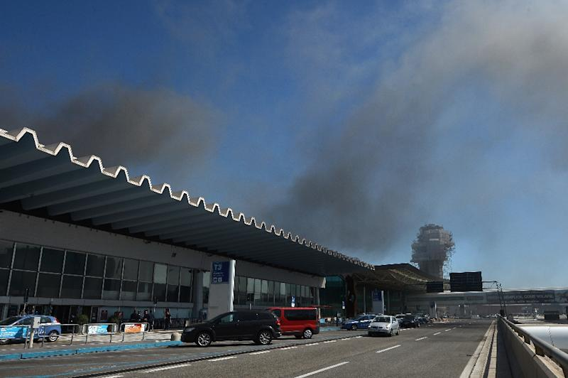 Italian authorities were recently forced to halt all flights from Rome's Fiumicino international airport after a fire broke out in one of the terminals on May 7, 2015 (AFP Photo/Tiziana Fabi)