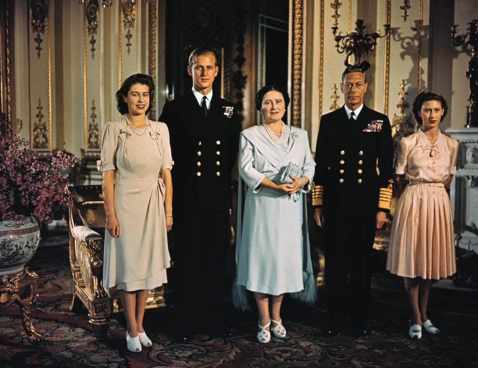 (Original Caption) Photograph shows Princess Elizabeth, Lieutenant Phillip Mountbatten, her then fiance, her mother, then Queen Elizabeth, now the Queen Mother, and her father, King George VI, in a family photograph made shortly before the Princess's wedding.