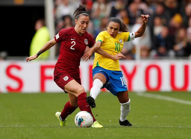 England's Lucy Bronze in action with Brazil's Marta Action Images via Reuters/Lee Smith