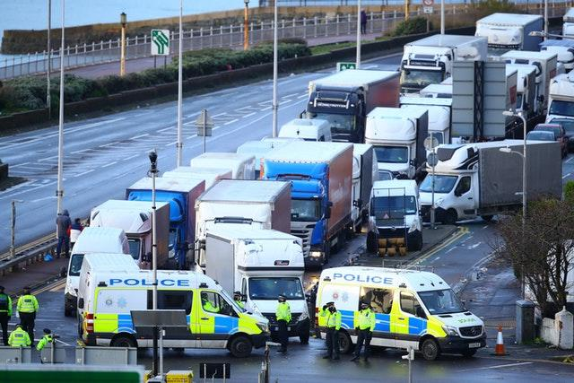 Police control the movements of vehicles at the entrance to the Port of Dover