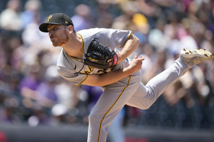 Pittsburgh Pirates starting pitcher Chad Kuhl works against the Colorado Rockies in the second inning of a baseball game Wednesday, June 30, 2021, in Denver. (AP Photo/David Zalubowski)