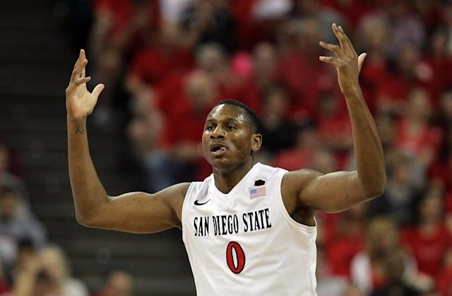 San Diego State's Skylar Spencer raises his hands to the crowd after dunking during the first half of an NCAA college basketball game against New Mexico for the Mountain West Conference tournament championship on Saturday, March 15, 2014, in Las Vegas. (AP Photo/Isaac Brekken)