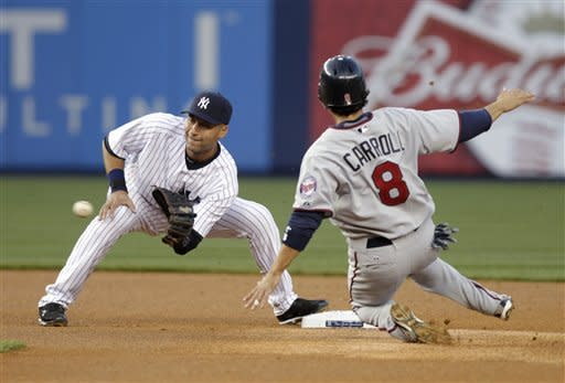 New York Yankees shortstop Derek Jeter, left, gets the ball in time to prevent Minnesota Twins' Jamey Carroll from stealing second during the first inning of a baseball game at Yankee Stadium in New York, Monday, April 16, 2012. (AP Photo/Seth Wenig)