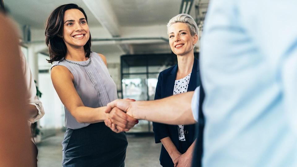 Business people shaking hands in the office.
