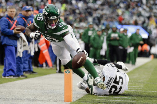 New York Jets running back Le'Veon Bell (26) reaches toward the end zone as he is forced out bounds by Oakland Raiders' Erik Harris (25) during the second half of an NFL football game Sunday, Nov. 24, 2019, in East Rutherford, N.J. (AP Photo/Adam Hunger)