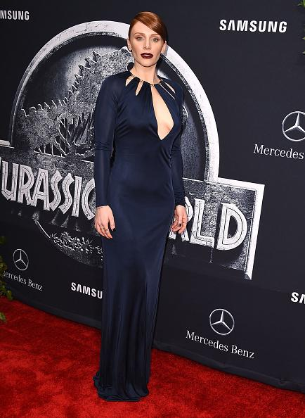"How do you know this isn't Jessica Chastain? Besides Bryce Dallas Howard's public declaration on social media letting the world know the two women aren't synonymous (no matter how much they look alike), Chastain would never (never say never but…) wear a dress like the one her doppelgänger wore to the ""Jurassic World"" premiere. She stunned on the red carpet in a floor-length midnight blue gown with neckline cutouts."