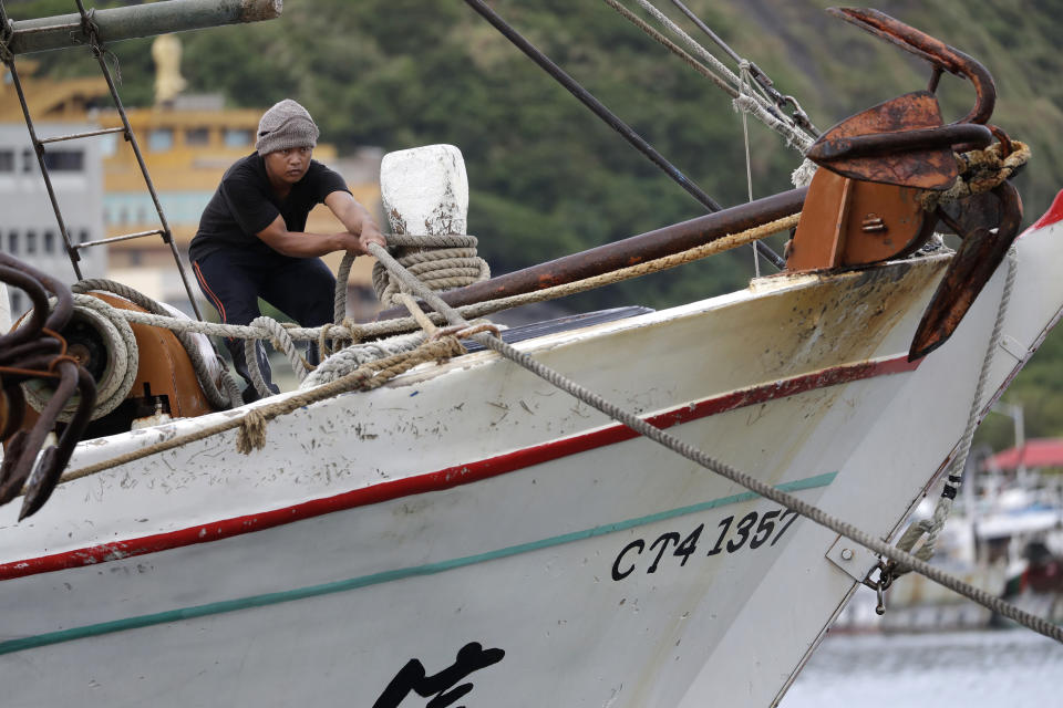 A fisherman fastens a boat to take shelter as Typhoon Chanthu approaches to Taiwan in Keelung, New Taipei City, Taiwan, Saturday, Sept. 11, 2021. Taiwan's weather bureau warned of high winds and heavy rain as Typhoon Chanthu roared toward the island Saturday and said the storm's center was likely to pass its east coast instead of hitting land. (AP Photo/Chiang Ying-ying)