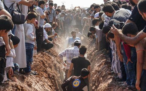The murdered White Helmets were buried on Saturday in Idlib - Credit: OMAR HAJ KADOUR/AFP/Getty Images