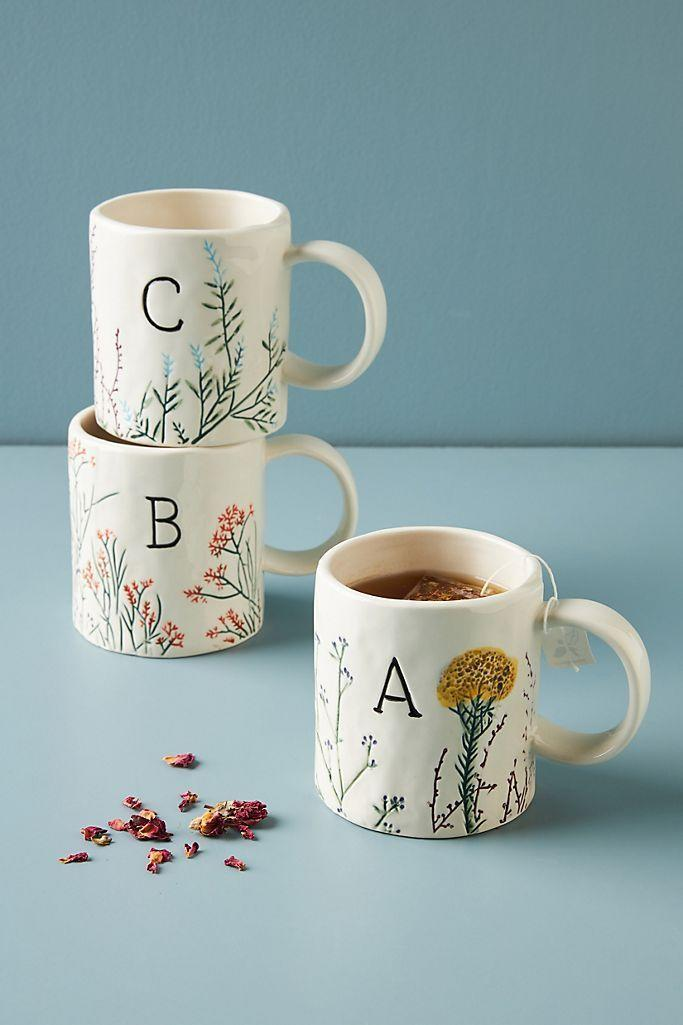 """<p><strong>Anthropologie</strong></p><p>anthropologie.com</p><p><strong>$14.00</strong></p><p><a href=""""https://go.redirectingat.com?id=74968X1596630&url=https%3A%2F%2Fwww.anthropologie.com%2Fshop%2Fdagny-monogram-mug&sref=https%3A%2F%2Fwww.countryliving.com%2Fshopping%2Fgifts%2Fg34500004%2Fmonogram-gift-ideas%2F"""" rel=""""nofollow noopener"""" target=""""_blank"""" data-ylk=""""slk:Shop Now"""" class=""""link rapid-noclick-resp"""">Shop Now</a></p><p>Enjoy morning coffee and bedtime tea with this hand-painted monogram stoneware mug that's dishwasher and microwave safe.<br></p>"""