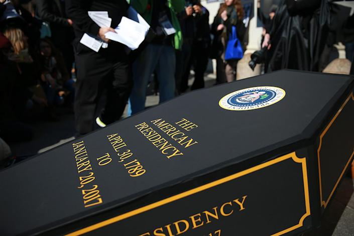 """<p>A casket is propped up during the """"A Mock Funeral for President's Day"""" rally at Washington Square Park in New York, Feb. 18, 2017. (Gordon Donovan/Yahoo News) </p>"""