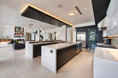 Don't be fooled by its sleek design. The kitchen is equipped to please the gourmet chef while also serving as an excellent hub for entertaining. WaterfrontLuxuryAuction.com.