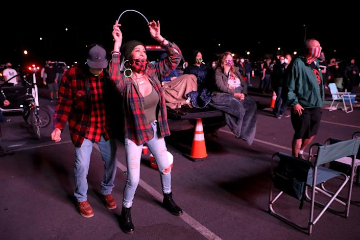 Natalie Vidal and her husband, Brandon, left, dance to Fishbone at Concerts in Your Car.