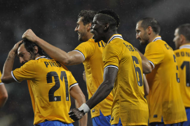 Juventus's Paul Pogba of France celebrates after his teammate Fernando Llorente scored a goal during their Serie A soccer match against Sassuolo, at Reggio Emilia's Mapei stadium, Italy, Monday, April 28, 2014. (AP Photo/Marco Vasini)