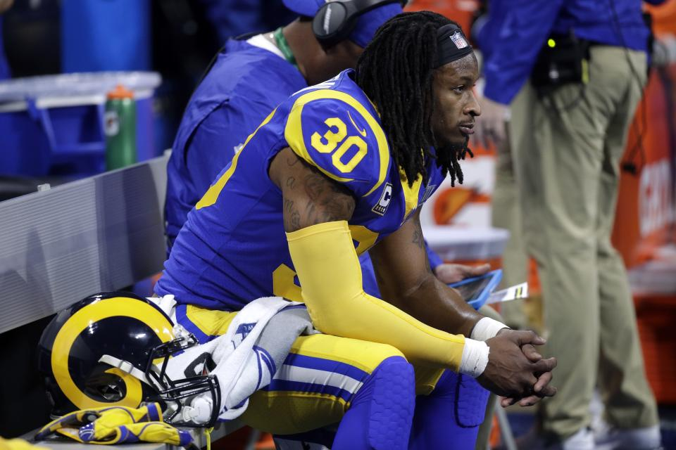 Todd Gurley watches from the bench during the first half of the Rams' 13-3 Super Bowl loss to the Patriots. (AP)