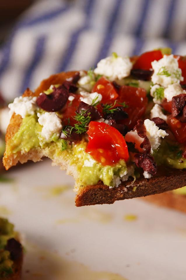 """<p><span>The toastest with the mostest.</span></p><p><span>Get the recipe from <a rel=""""nofollow"""" href=""""http://www.delish.com/cooking/recipe-ideas/recipes/a53555/greek-avocado-toast-recipe/"""">Delish</a>.</span></p>"""