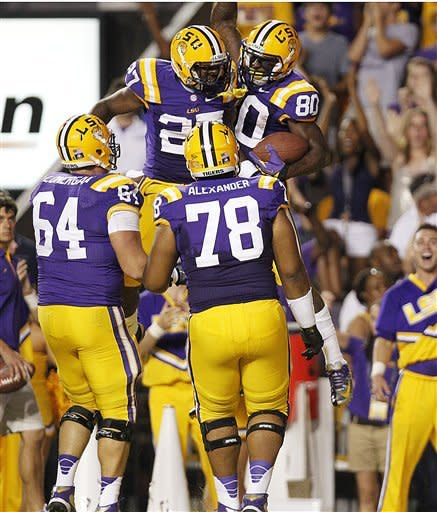 LSU wide receiver Jarvis Landry (80) celebrates his touchdown reception with running back Kenny Hilliard (27) in the first half of their NCAA college football game against Idaho in Baton Rouge, Saturday, Sept. 15, 2012. (AP Photo/Gerald Herbert)
