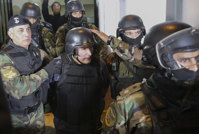 Argentinian ex-minister Jose Lopez (centre) is arrested in Buenos Aires, on June 14, 2016