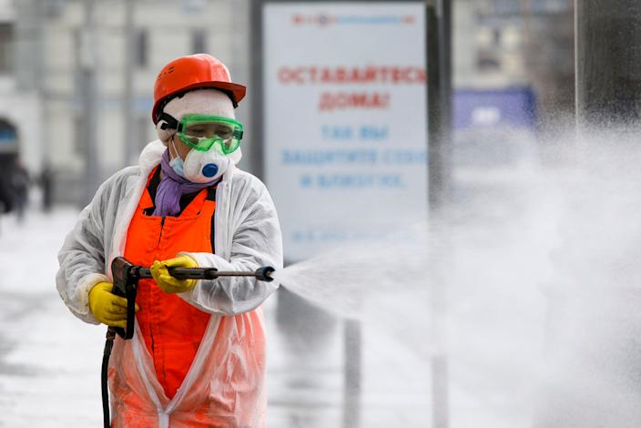 A municipal worker in Russia spraying disinfectant as a precaution against the coronavirus on April 12.