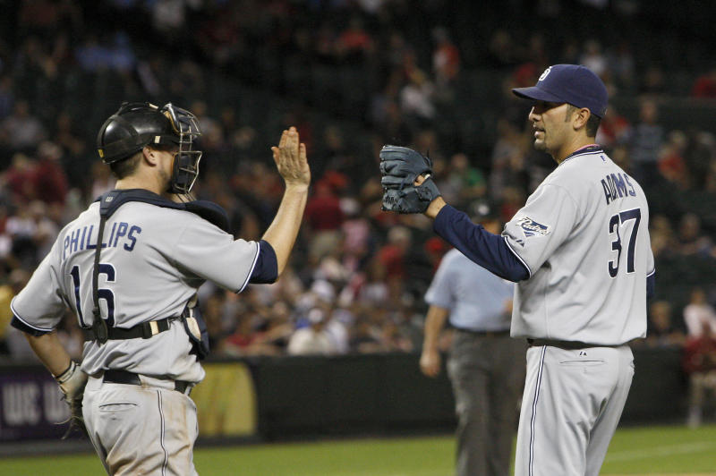 San Diego Padres' Mike Adams (37) celebrates the final out with teammate San Diego Padres' Kyle Phillips (16) after the ninth inning of an MLB baseball game against the Arizona Diamondbacks Monday, May 16, 2011, in Phoenix.  The Padres defeated the Diamondbacks 8-4. (AP Photo/Ross D. Franklin)
