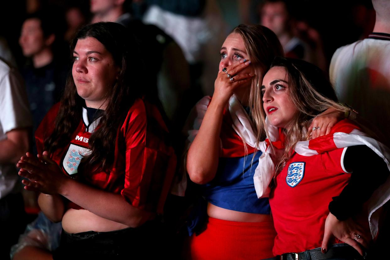 England fans are dejected after England lose the game on penalties at Vinegar Yard, London as they watch the UEFA Euro 2020 Final between Italy and England. Picture date: Sunday July 11, 2021.