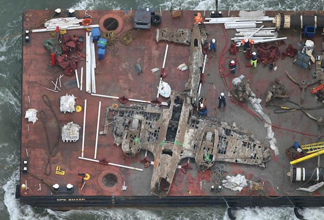 A World War II Dornier 17 aircraft is transported on a barge to harbour on June 11, 2013 near Ramsgate, England. The salvage operation, planned through the RAF Museum, lifted the only remaining German bomber Dornier 17, used during the 'Battle of Britain' of 1940 from the sea on June 10, 2013.. The plane is believed to be aircraft call-sign 5K-AR, shot down on August 26, 1940 at the height of the battle by RAF Boulton-Paul Defiant fighters. The aircraft will be preserved and put on display for the public at the museum's Hendon base in north London. (Photo by Peter Macdiarmid/Getty Images)