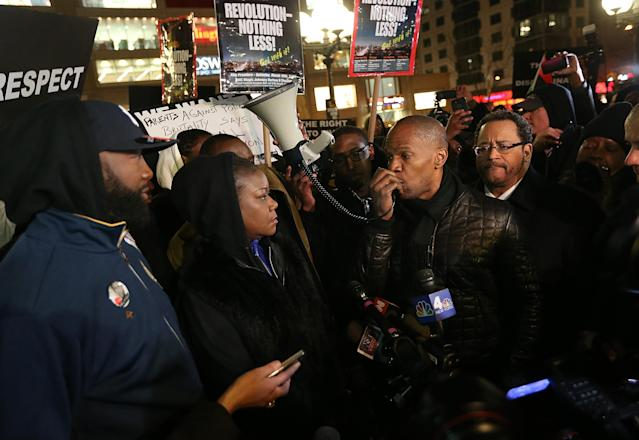 NEW YORK, NY - FEBRUARY 26: Tracy Martin (L) and Sybrina Fulton (2nd L), Trayvon Martin's parents, actor Jamie Foxx (2nd R) and author Michael Eric Dyson (R) attend a candlelight vigil for Martin in Union Square on February 26, 2013 in New York, New York. Some participants wore hoodies to honor Martin. Vigils were held in Florida and New York on the one year anniversary of teenager Trayvon Martin's shooting death by George Zimmerman in Florida. (Photo by Mario Tama/Getty Images)