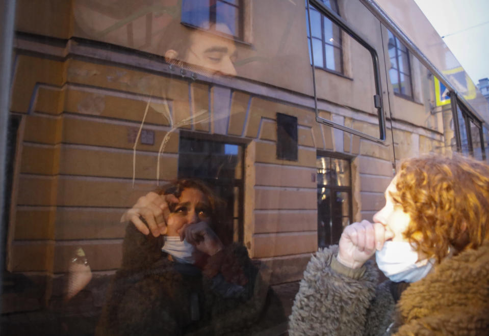 A detained protestor looks on from inside a police van during a protest in support of jailed opposition leader Alexei Navalny in St. Petersburg, Russia, Wednesday, April 21, 2021. A human rights group that monitors political repressions said at least 400 people were arrested across the country in connection with the protests. Many were seized before protests even began, including two top Navalny associates in Moscow. (AP Photo/Dmitri Lovetsky)