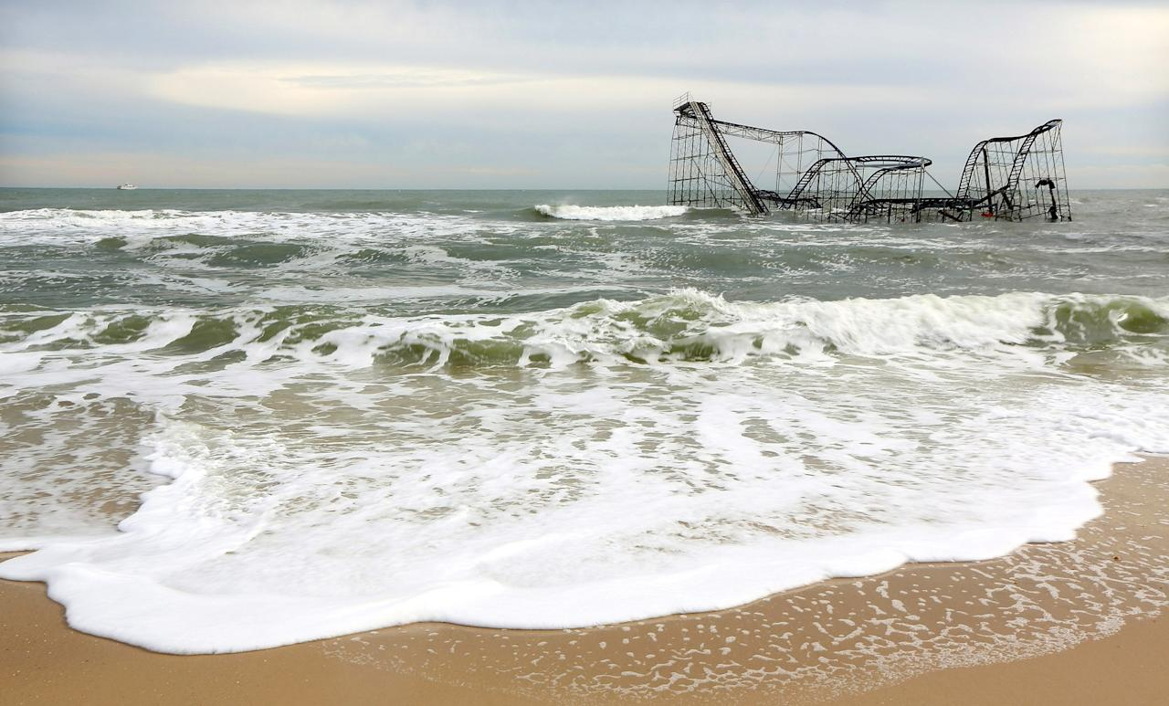SEASIDE HEIGHTS, NJ - NOVEMBER 16:   Waves break around a destroyed roller coaster on November 16, 2012 in Seaside Heights, New Jersey. Two amusement piers and a number of roller coasters in the seaside town were destroyed by Superstorm Sandy.  (Photo by Mario Tama/Getty Images)