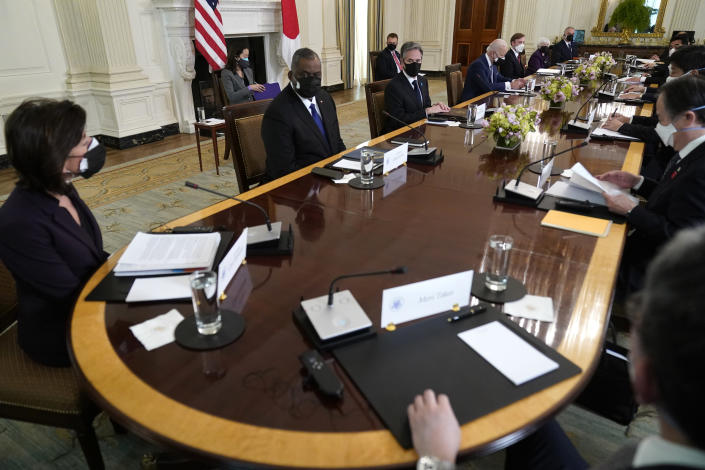 President Joe Biden meets with Japanese Prime Minister Yoshihide Suga in the State Dining Room of the White House, Friday, April 16, 2021, in Washington. (AP Photo/Andrew Harnik)