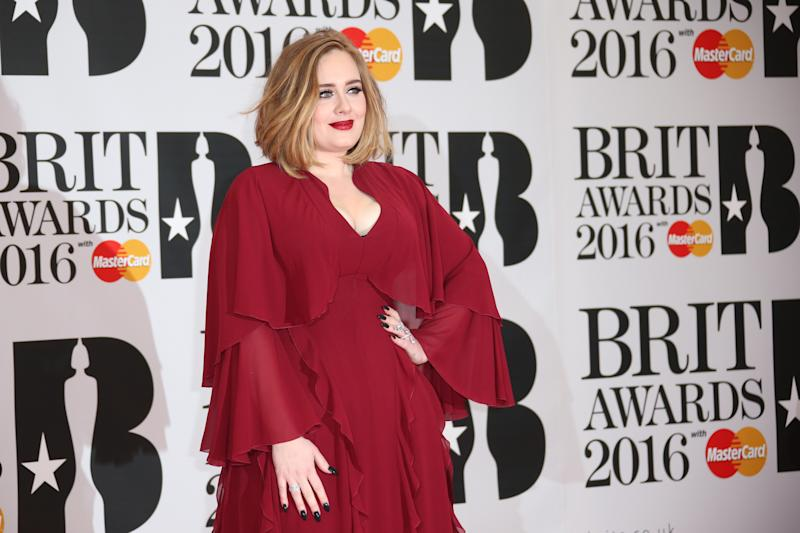 Singer Adele poses for photographers upon arrival for the Brit Awards 2016 at the 02 Arena in London, Wednesday, Feb. 24, 2016. (Photo by Joel Ryan/Invision/AP)