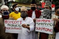 Muslim activists from various organizations participate in a protest against France, near the French Consulate, in Kolkata, India, Saturday, Oct. 31, 2020. Muslims have been calling for both protests and a boycott of French goods in response to France's stance on caricatures of Islam's most revered prophet. (AP Photo/Bikas Das)