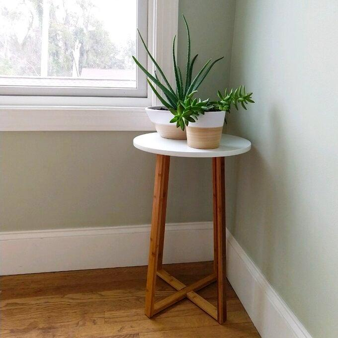 """<h2>Ebern Designs Wellston Plant Table</h2><br><strong>Deal: 30% Off</strong><br>Just one of this cute-little plant stand's many reviewer fans states, """"Simple, beautiful, and easy to put together. I am using it as a plant stand, and it looks lovely on the landing of our stairs."""" But we can also see it serving as a makeshift laptop stand, TV dinner for us singles, or a beside water-glass station.<br><br><strong>Ebern Designs</strong> Wellston Plant Table, $, available at <a href=""""https://go.skimresources.com/?id=30283X879131&url=https%3A%2F%2Fwww.wayfair.com%2Ffurniture%2Fpdp%2Febern-designs-wellston-plant-table-ccli1005.html%23yt5k783utm-7"""" rel=""""nofollow noopener"""" target=""""_blank"""" data-ylk=""""slk:Wayfair"""" class=""""link rapid-noclick-resp"""">Wayfair</a>"""