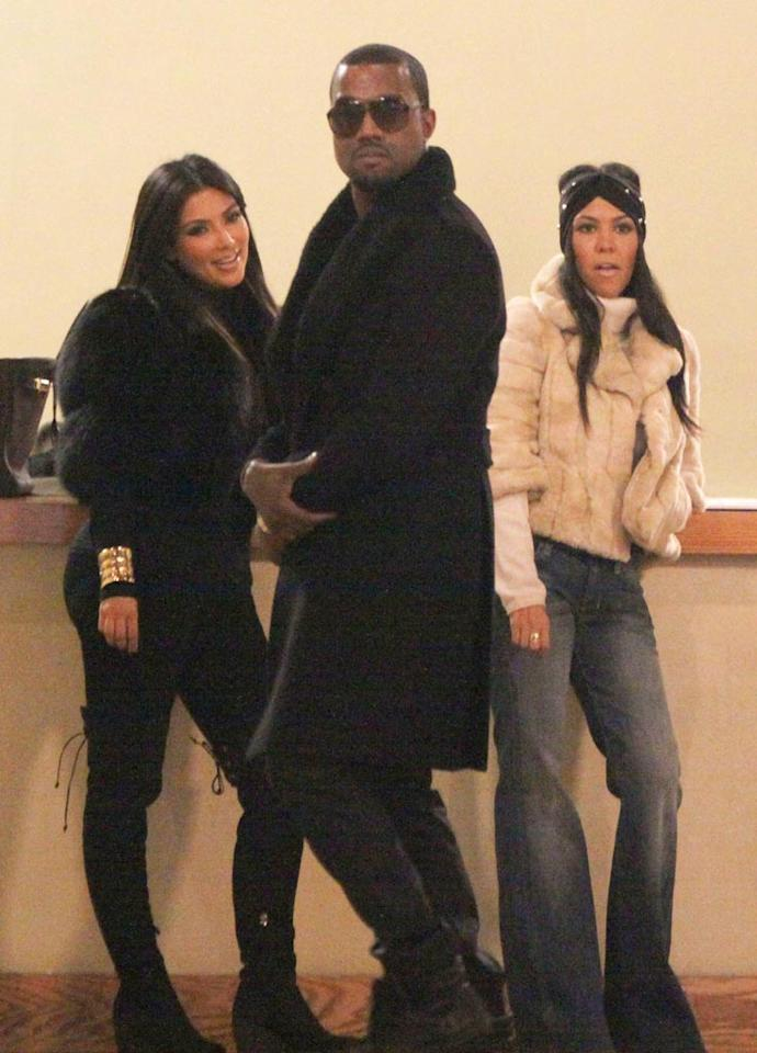 """Monday saw fashionably attired siblings Kim and Kourtney Kardashian hooking up with rapper Kanye West at the site of their future Soho Dash store, around which their new series, """"Kourtney and Kim Take New York,"""" will revolve. Who knew they were friends?! Jose Perez/<a href=""""http://www.splashnewsonline.com"""" target=""""new"""">Splash News</a> - October 4, 2010"""