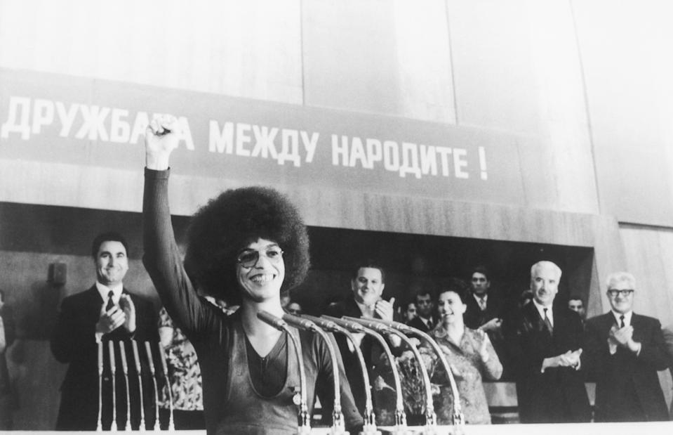Showing a Black Power salute, activist Angela Davis earns warm applause during a meeting held in honor of her visit to Bulgaria. (Photo: Getty Images)