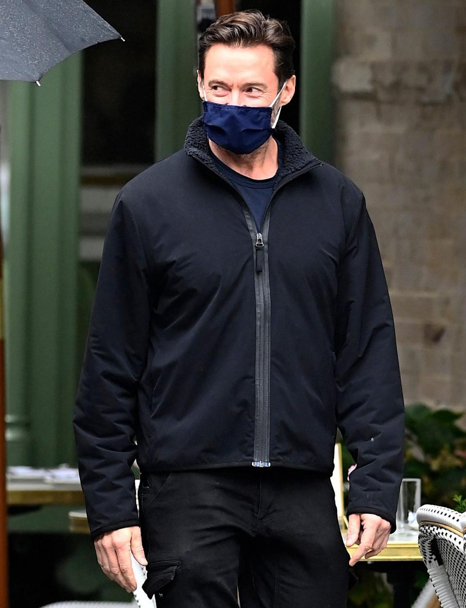 <p>Hugh Jackman seems to be smiling beneath his face mask as he walks to lunch with a friend in N.Y.C. on Monday.</p>