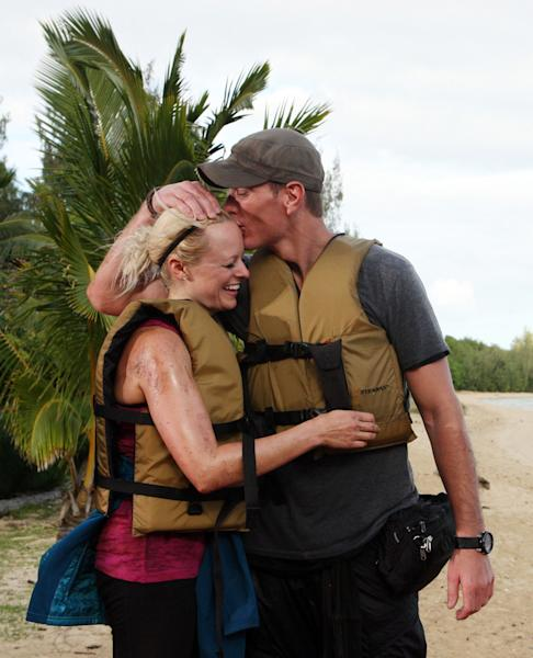"""In this undated image released by CBS, Rachel and Dave Brown are shown after winning on the latest edition of """"The Amazing Race,"""" which aired Sunday, May 6, 2012 on CBS. The Madison, Wis., couple outlasted 10 other couples to win the $1 million grand prize. Dave Brown is in the Wisconsin Army National Guard and served in Iraq. He also teaches military science at the University of Wisconsin-Madison. Rachel Brown is a project manager for a software company. Because Dave has been deployed overseas, and Rachel frequently travels on business, they say one of the most rewarding parts of the competition was the chance to spend so much time together. (AP Photo/CBS, Monty Brinton)"""
