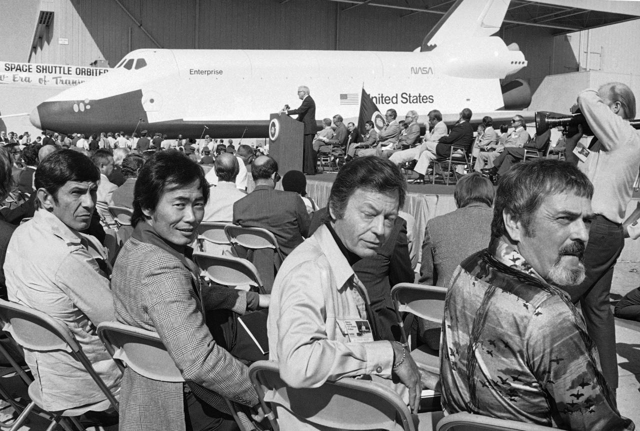 "FILE - In this Friday, Sept. 17, 1976 file photo, cast members from the television series Star Trek, from left, Leonard Nimoy who portrayed Spock; George Takei who was Sulu; DeForest Kelly who was Dr. McCoy and James Doohan, who was Scotty, attend a ceremony for the space shuttle prototype Enterprise in Palmdale, Calif. Most of the shuttles were named after seafaring ships of yore: Columbia, Challenger, Discovery, Atlantis and Endeavour. The prototype Enterprise was the exception, named after the ""Star Trek"" starship at fans' request. (AP Photo)"