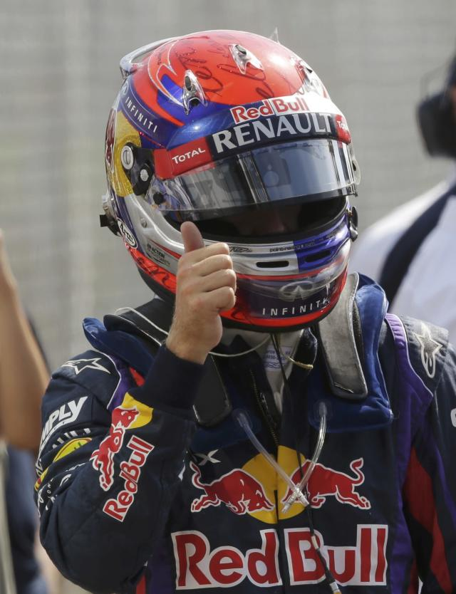 Red Bull Formula One driver Sebastian Vettel of Germany celebrates taking the pole position in the qualifying session of the Italian F1 Grand Prix at the Monza circuit September 7, 2013. REUTERS/Max Rossi (ITALY - Tags: SPORT MOTORSPORT F1)